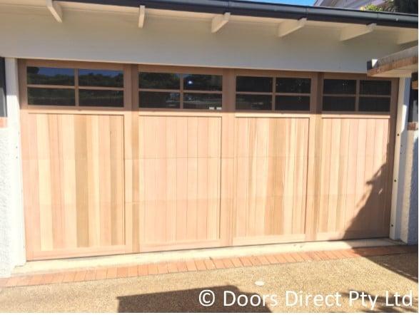 Accreditation & Danmar Carriage Panel door in Raw Finish - Doors Direct